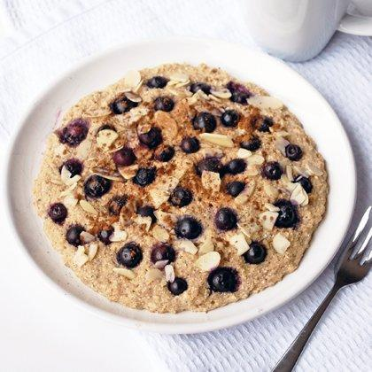 """<p>Who says you can't have dessert for breakfast? This mildly sweet cookie, fortified with fiber-rich oats and ground flax, is easy to prepare and take with you on the go (BTW these <a href=""""https://www.shape.com/healthy-eating/healthy-recipes/easy-slow-cooker-dessert-recipes"""" target=""""_blank"""">slow cooker dessert recipes</a> require minimal effort, too).</p> <p><b>Ingredients:</b><br /> 1/4 cup oats<br /> 2 tablespoons buckwheat or all-purpose flour<br /> 1/4 teaspoon baking powder<br /> 1 tablespoon ground flaxseeds or chia seeds<br /> Ground cinnamon to taste<br /> Vanilla extract to taste<br /> 1 tablespoon maple syrup<br /> 3 tablespoons soy or regular yogurt<br /> 1/4 cup frozen blueberries<br /> 1 tablespoon sliced almonds (or nuts of your choice)</p> <p><b>Directions:</b><br /> Combine oats, flour, baking powder, flaxseeds, cinnamon, vanilla, maple syrup, and yogurt, mixing and mashing well to form a thick, sticky ball of dough. Roughly flatten with palms and place on a small microwaveable plate. Push blueberries into dough evenly across the top, sprinkle with almonds, and dust with additional cinnamon, if desired. Microwave on high for 1 minute. Press surface with your finger: Cookie is ready when it springs back, there are no visibly sticky parts, and berries are fully cooked.</p> <p><b>Nutrition score per serving:</b> 310 calories, 7.5g fat, 52.5g carbs, 10g protein</p> <p><i>Recipe provided by <a href=""""http://www.includingcake.com/p/my-recipage.html?recipe_id=6022243"""" target=""""_blank"""">Including Cake</a></i></p>"""