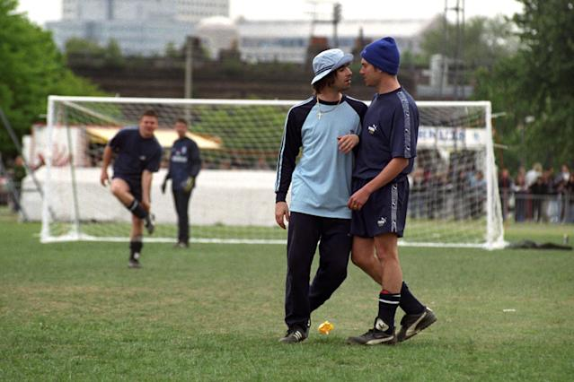 (L-R) Liam Gallagher, of Oasis, and Damon Albarn, of Blur, during the second Music Industry 'Soccer Six' football tournament at Mile End Stadium. (Photo by David Cheskin - PA Images/PA Images via Getty Images)
