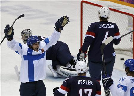 Finland's Teemu Selanne (L) celebrates his goal as Team USA's Ryan Kesler and John Carlson react during the third period of their men's ice hockey bronze medal game at the Sochi 2014 Winter Olympic Games February 22, 2014. REUTERS/Grigory Dukor