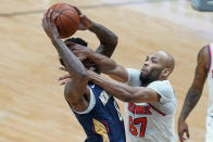 New York Knicks center Taj Gibson (67) fouls New Orleans Pelicans forward Naji Marshall (8) as he drives to the basket in the second half of an NBA basketball game in New Orleans, Wednesday, April 14, 2021. (AP Photo/Gerald Herbert)