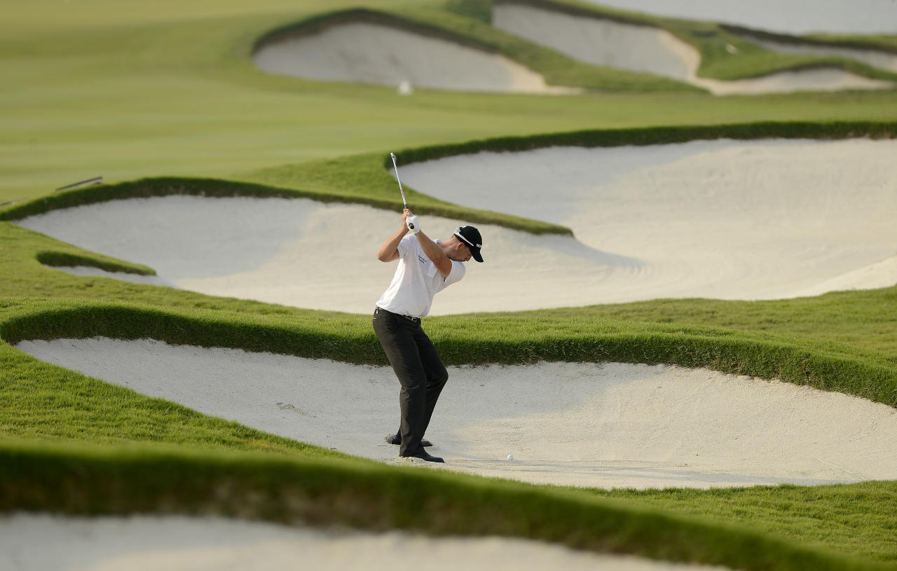 BANGKOK, THAILAND - DECEMBER 15: Henrik Stenson of Sweden plays a shot  during day four of the Thailand Golf Championship at Amata Springs Country Club on December 15, 2013 in Bangkok, Thailand.  (Photo by Paul Lakatos/Asian Tour/Asian Tour via Getty Images)