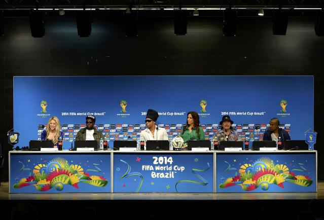 Performers (L-R) Shakira, Wyclef Jean, Carlinhos Brown, Ivete Sangalo, Carlos Santana and Alexandre Pires listen to questions during a news conference at the Maracana stadium in Rio de Janeiro July 12, 2014. These artists will perform at the closing ceremony of the 2014 World Cup Final between Germany and Argentina on Sunday. REUTERS/Dylan Martinez (BRAZIL - Tags: SOCCER SPORT WORLD CUP ENTERTAINMENT)