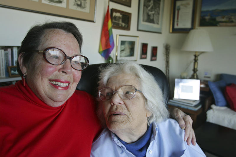 FILE - In this Dec. 17, 2004, file photo, Phyllis Lyon, left, and her partner Del Martin, right, sit for a photograph at their home in San Francisco. Pioneering gay rights activist Lyon, who was among the first same-sex couples to marry in California when it became legal to do so in 2008, has died at her San Francisco home. Lyon died at age 95 of natural causes Thursday, April 9, 2020. (AP Photo/Eric Risberg, File)