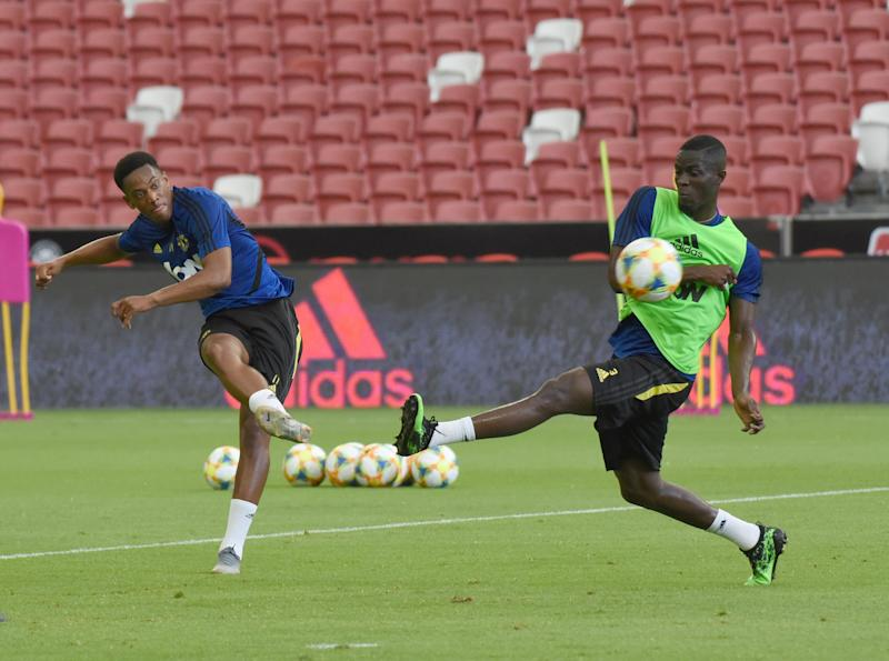 Manchester United players Anthony Martial (left) and Paul Pogba during training at the National Stadium for the International Champions Cup. (PHOTO: Zainal Yahya/Yahoo News Singapore)