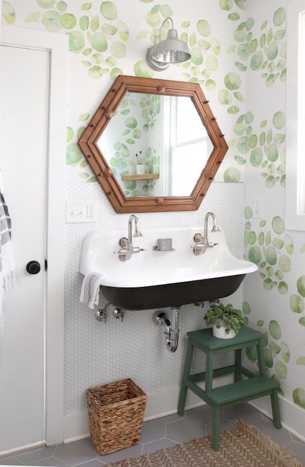 """<p>No wet saw, no problem! These smart tiles that <a href=""""https://ispydiy.com/diy-home-guest-bathroom-makeover-with-removable-wallpaper-tile/"""" target=""""_blank"""">Jenni Radosevich of I Spy DIY </a>used to create a custom backsplash are insanely easy to apply. No messy grout or specialty tools are needed. They're a clever solution in a rental where you're planning on staying long term—plus they can be applied right over any clean, flat surface. </p>"""