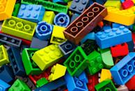 "The name ""LEGO"" is so well-known you've probably never stopped to think about where the seemingly random word comes from. But according to the company itself, ""LEGO"" is an abbreviation of the Danish words ""<a href=""https://www.lego.com/en-us/aboutus/lego-group/the-lego-group-history/"" rel=""nofollow noopener"" target=""_blank"" data-ylk=""slk:leg godt"" class=""link rapid-noclick-resp"">leg godt</a>,"" meaning ""play well."" They say, ""It's our name and it's our ideal."""