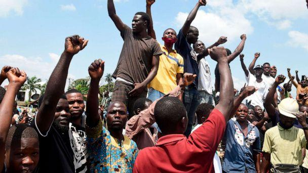 PHOTO: Protesters chant and sing solidarity songs as they barricade barricade the Lagos-Ibadan expressway to protest against police brutality and the killing of protesters by the military, at Magboro, Ogun State, on Oct. 21, 2020. (Pius Utomi Ekpei/AFP via Getty Images)