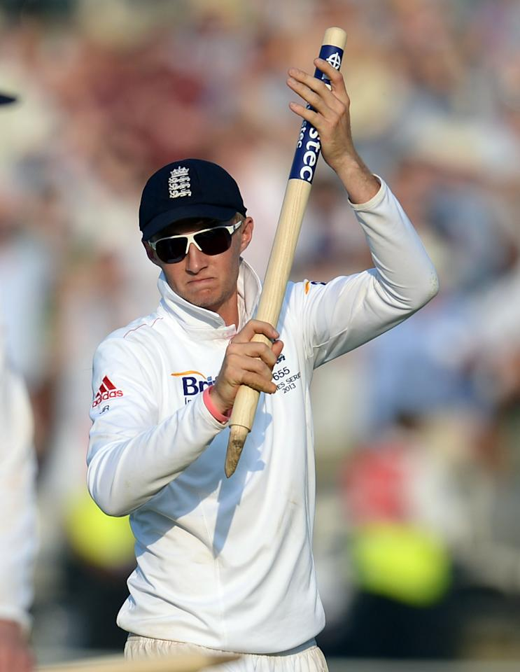 England's Joe Root celebrates defeating Australia in the second Test on day four of the Second Investec Ashes Test at Lord's Cricket Ground, London.