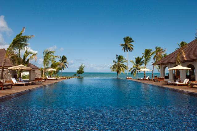 The Residence, Zanzibar. Eighty acres of palm forests open out onto the ocean at this beachfront resort whose infinity pool languidly stretches out towards the gorgeous African sunset. Few things can compare. (www.theresidence.com/zanzibar)