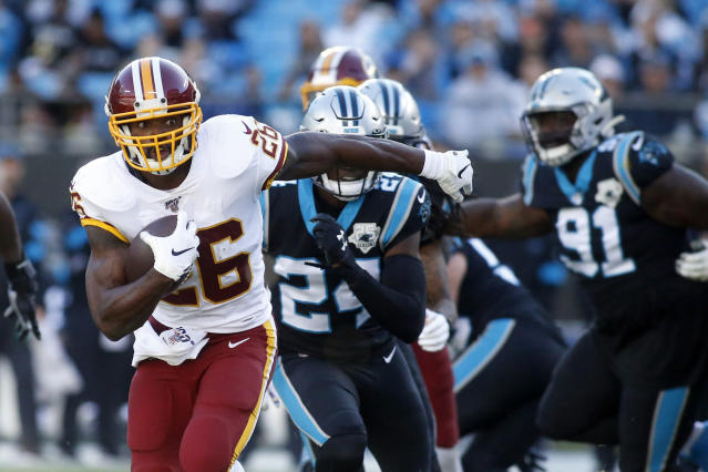 Washington Redskins running back Adrian Peterson (26) runs against the Carolina Panthers during the second half of an NFL football game in Charlotte, N.C., Sunday, Dec. 1, 2019. (AP Photo/Brian Blanco)