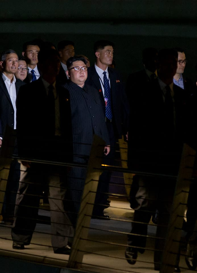 <p>North Korean leader Kim Jong Un, pictured here with Singapore's Foreign Minister Vivian Balakrishnan (far left), seen walking along the Esplanade Bridge on 11 June 2018. (PHOTO: AP) </p>