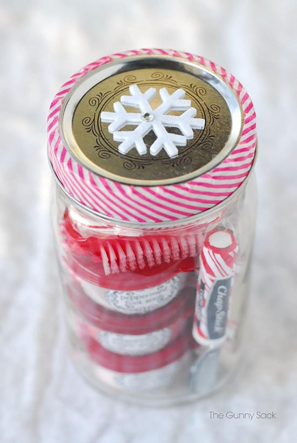 """<p>For an easy-to-make Christmas gift, blogger Tonia made peppermint-themed presents by filling Mason jars with handmade peppermint spa products, like body butter, sugar scrub, and foot soak.</p><p><strong>Get the tutorial at <a href=""""http://www.thegunnysack.com/2013/11/peppermint-pampering-gifts-in-jars-for-homemade-christmas-gifts.html"""" rel=""""nofollow noopener"""" target=""""_blank"""" data-ylk=""""slk:The Gunny Sack"""" class=""""link rapid-noclick-resp"""">The Gunny Sack</a>.</strong></p><p><a class=""""link rapid-noclick-resp"""" href=""""https://www.amazon.com/Clear-Empty-Plastic-Cosmetic-Containers/dp/B00J7A4SAW/?tag=syn-yahoo-20&ascsubtag=%5Bartid%7C10050.g.2132%5Bsrc%7Cyahoo-us"""" rel=""""nofollow noopener"""" target=""""_blank"""" data-ylk=""""slk:SHOP PLASTIC JARS"""">SHOP PLASTIC JARS</a></p>"""
