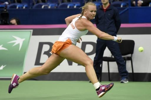 Russia humiliated in Fed Cup, Swiss into semi-finals