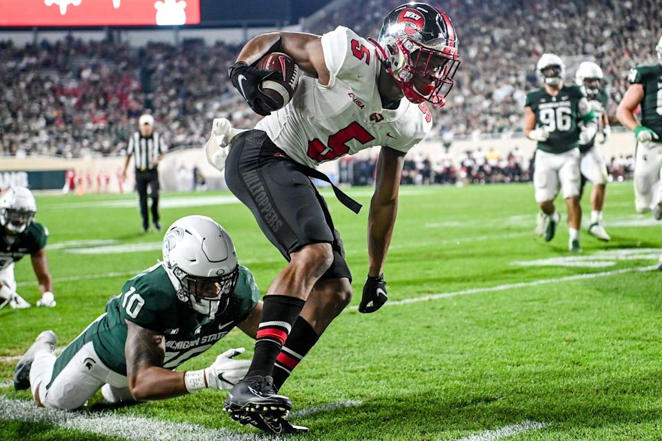 Michigan State's Payton Ma'a Gaoteote, left, tackles Western Kentucky's Mitchell Tinsley during the first quarter on Saturday, Oct. 2, 2021, at Spartan Stadium in East Lansing.