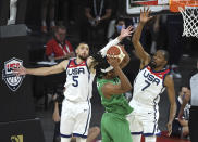 United States' Zach LaVine (5) and Kevin Durant (7) defend against Nigeria's Chima Moneke during an exhibition basketball game Saturday, July 10, 2021, in Las Vegas. (AP Photo/David Becker)