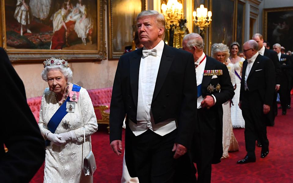 Queen Elizabeth II, US President Donald Trump and the Prince of Wales arrive through the East Gallery during the State Banquet at Buckingham Palace, London, on day one of the US President's three day state visit to the UK.