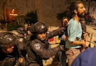 Several young Palestinians being detained by police after scuffles broke out