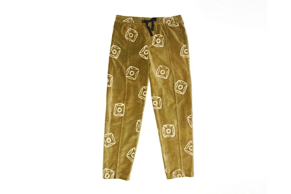 "$325, Post Imperial. <a href=""https://post-imperial.com/collections/jollof/products/ikoyi-velvet-pant-jollof-squares-olive"" rel=""nofollow noopener"" target=""_blank"" data-ylk=""slk:Get it now!"" class=""link rapid-noclick-resp"">Get it now!</a>"