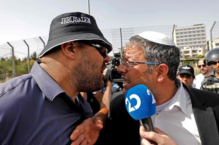 A Palestinian man argues with Itamar Ben-Gvir, right, a member of the Israeli Knesset and head of the far-right Jewish Power (Otzma Yehudit) party, in the Sheikh Jarrah neighborhood of the Israeli-annexed East Jerusalem on May 10.