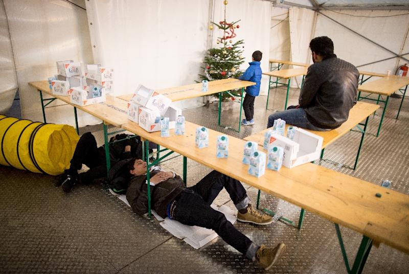 Asylum seekers wait in a tent to register at the State Office of Health and Social Affairs in Berlin on December 2, 2015 (AFP Photo/Kay Nietfeld)