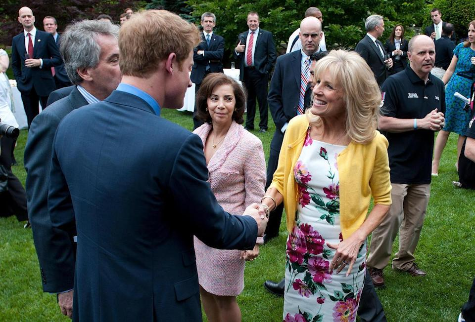 Prince Harry greets Dr Jill Biden (R), the wife of U.S Vice President Joe Biden, during a reception for U.S and British wounded warriors at the British Ambassador's Residence in Washington, D.C on May 7, 2012