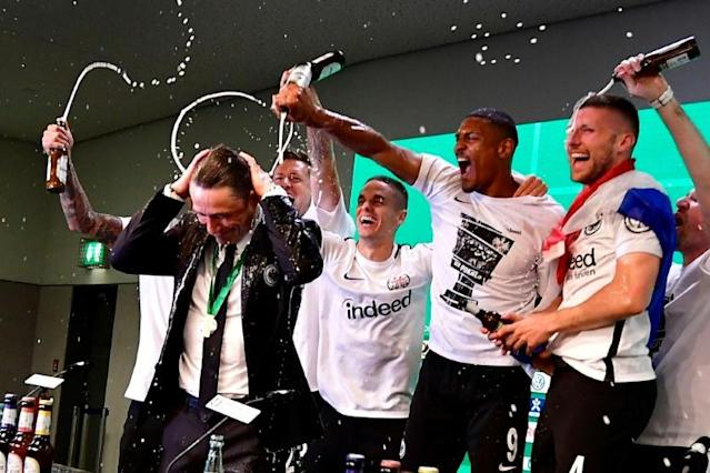 Frankfurt's Croatian head coach Niko Kovac reacts after his players soak him in beer at the press conference after the German Cup DFB Pokal final football match FC Bayern Munich vs Eintracht Frankfurt at the Olympic Stadium in Berlin on May 19, 2018