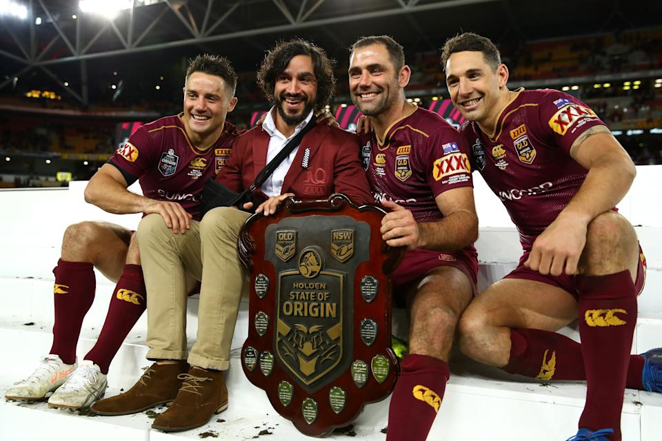 Cooper Cronk, Johnathan Thurston, Cameron Smith and Billy Slater smile and pose with the State of Origin Trophy in 2017.