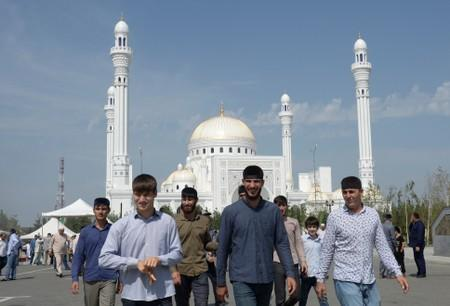 People walk near a mosque after an inauguration ceremony in Shali
