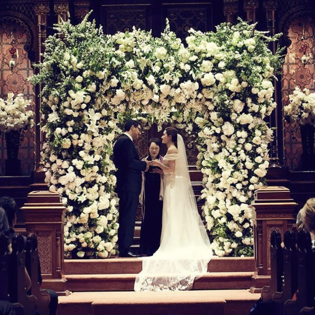 <p>The 'Phantom of the Opera' film and TV star tied the knot in a stunning Carolina Herrera dress, which boasted an off-the-shoulder design, embroidery and veil. <br /><em>[Photo: Instagram/Emmy Rossum]</em> </p>