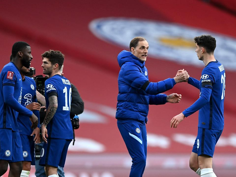 Chelsea coach Thomas Tuchel (second right) celebrates with his players (The FA via Getty Images)