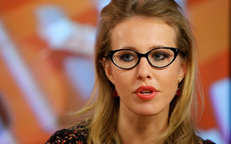 Ksenia Sobchak gives a radio interview in 2012. - AP