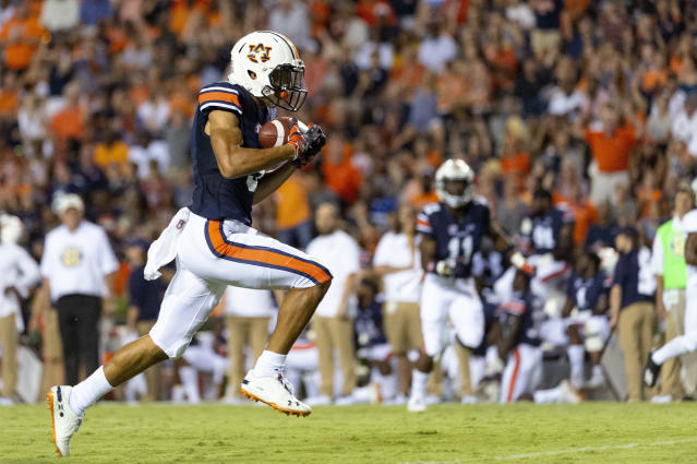 Auburn wide receiver Anthony Schwartz (5) grabs a pass from quarterback Jarrett Stidham and runs for a touchdown against Alabama State during an NCAA college football game Saturday, Sept. 8, 2018, in Auburn, Ala. (AP Photo/Vasha Hunt)