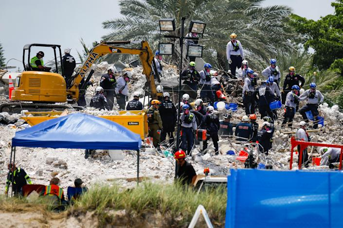 Rescue workers at the Champlain Tower in Surfside on July 5, 2021. / Credit: Eva Marie Uzcategui Trinkl/Anadolu Agency via Getty