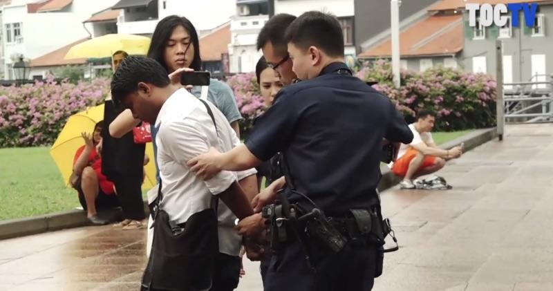 Activist and artist Seelan Palay was arrested outside Parliament House on 1 October, 2017 by police officers. He was listed as one of the speakers involved in the programme. (SCREENSHOT: The Online Citizen/Facebook)