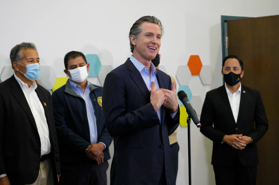 Governor Gavin Newsom spoke with news reporters about San Diego's newest pop-up vaccination site at the Park de la Cruz Recreation Center in the City Heights neighborhood on Friday, April 2, 2021 in San Diego. Accompanying Newsom was Juan Vargas, Ben Hueso, Sean Elo-Rivera and Todd Gloria. (Nelvin C. Cepeda/The San Diego Union-Tribune via AP)