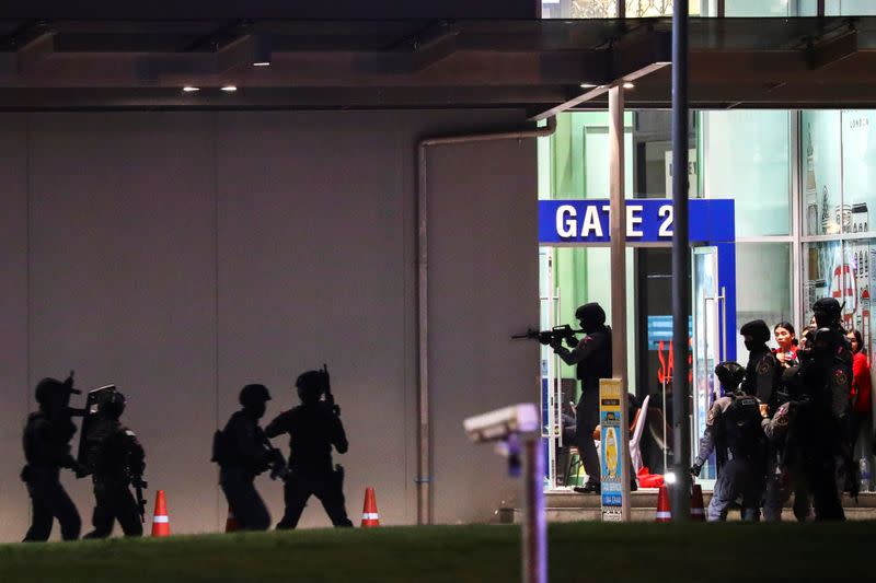 Thailand security forces enter in a shopping mall as they chase a shooter hidden in after a mass shooting in front of the Terminal 21, in Nakhon Ratchasima