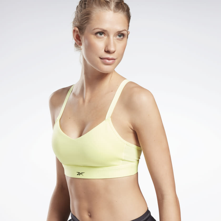 Lux Strappy Medium-Impact Sports Bra. Image via Reebok.