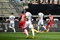 Bayer Leverkusen's Kai Havertz scores against Borussia Moenchengladbach on Saturday in front of carboard cut-out fans