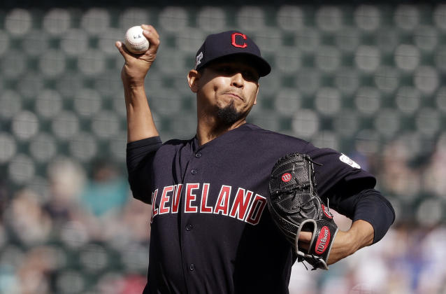 Cleveland Indians starting pitcher Carlos Carrasco throws to a Seattle Mariners batter during the first inning of a baseball game Wednesday, April 17, 2019, in Seattle. (AP Photo/Elaine Thompson)