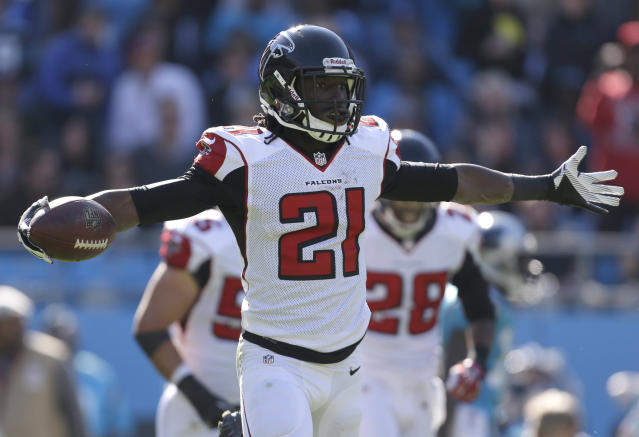 Atlanta Falcons' Desmond Trufant (21) celebrates his interception against the Carolina Panthers in the first half of an NFL football game in Charlotte, N.C., Sunday, Nov. 3, 2013. (AP Photo/Bob Leverone)