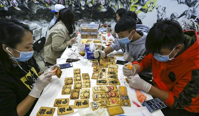 Young people working on handmade items under a scheme launched by Lung Mun Cafe's owner. Photo: Jonathan Wong