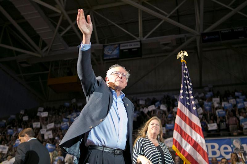 Sen. Bernie Sanders arrives with his wife Jane at a campaign rally on July 6, 2015, in Portland, Maine.
