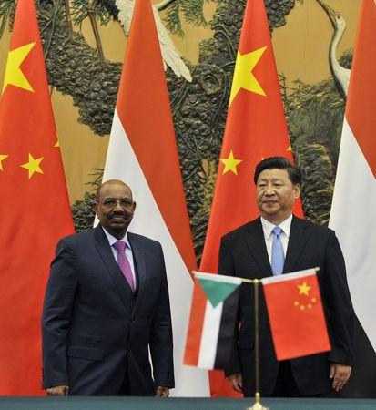 Sudanese President Omar Hassan al-Bashir attends a signing ceremony with Chinese President Xi Jinxing at the Great Hall of the People in Beijing