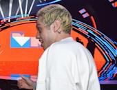 """<p>Pete Davidson and <a class=""""link rapid-noclick-resp"""" href=""""https://www.popsugar.co.uk/Ariana-Grande"""" rel=""""nofollow noopener"""" target=""""_blank"""" data-ylk=""""slk:Ariana Grande"""">Ariana Grande</a> got several tattoos showing off their love for each other during their five-month relationship. Less than a week after announcing they were dating, Davidson got the singer's iconic bunny ears tattooed behind his ear as well as her initials. </p> <p>Grande on the other hand <a href=""""https://www.popsugar.com/beauty/Ariana-Grande-Tattoo-Pete-Davidson-Late-Father-2018-45002207/"""" class=""""link rapid-noclick-resp"""" rel=""""nofollow noopener"""" target=""""_blank"""" data-ylk=""""slk:got the numbers 8418 tattooed on her foot"""">got the numbers 8418 tattooed on her foot</a> in July 2018 to honor Davidson's father, a former firefighter who was killed on 9/11. The former couple also got matching tattoos, including tiny clouds tattooed on their fingers and """"H2GKMO"""" (an acronym for """"Honest to God Knock Me Out"""") on their hands.</p> <p>After their breakup, Davidson revealed that he had been in the process of <a href=""""https://www.popsugar.com/beauty/Pete-Davidson-Talks-About-Covering-Ariana-Grande-Tattoos-45405020"""" class=""""link rapid-noclick-resp"""" rel=""""nofollow noopener"""" target=""""_blank"""" data-ylk=""""slk:covering up a few of the tattoos"""">covering up a few of the tattoos</a> that symbolized their relationship.</p>"""