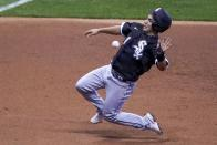 Chicago White Sox's Nick Madrigal races to third during the third inning of a baseball game against the Milwaukee Brewers Tuesday, Aug. 4, 2020, in Milwaukee. Madrigal tried to advance from first on a hit by Luis Robert. (AP Photo/Morry Gash)