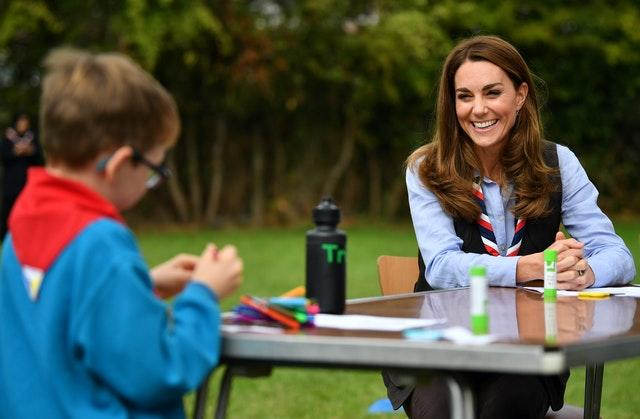 The Duchess of Cambridge joins Cubs and Beaver Scouts in outdoor activities during a visit to the 12th Northolt Scouts in West London