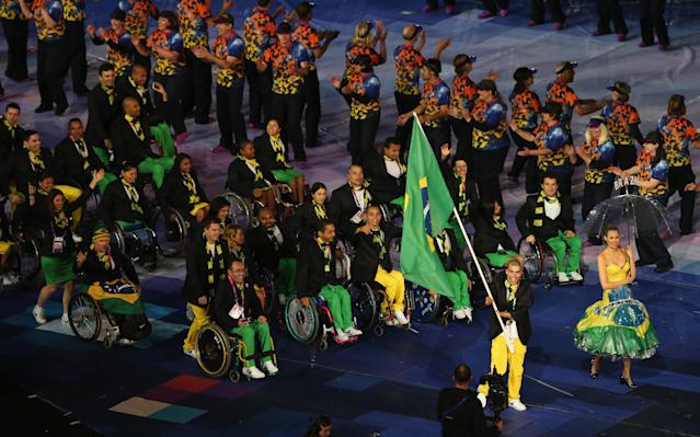 LONDON, ENGLAND - AUGUST 29: Swimmer Daniel Dias of Brazil carries the flag during the Opening Ceremony of the London 2012 Paralympics at the Olympic Stadium on August 29, 2012 in London, England. (Photo by Scott Heavey/Getty Images)