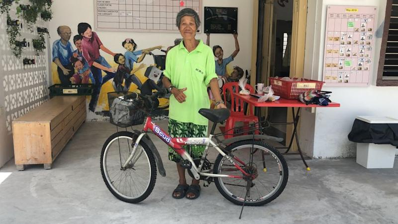 Wong Chik Yee, posing with her new bicycle which was donated by GHCA after her previous bike was stolen. — Picture courtesy of Great Heart Charity Association