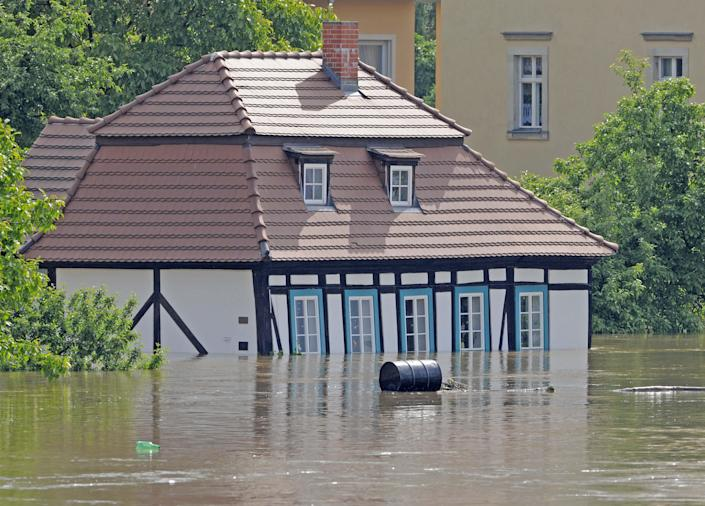 A house is flooded by river Elbe in Dresden, eastern Germany, Thursday, June 6, 2013. Heavy rainfalls cause flooding along rivers and lakes in Germany, Austria, Switzerland and the Czech Republic. (AP Photo/Jens Meyer)