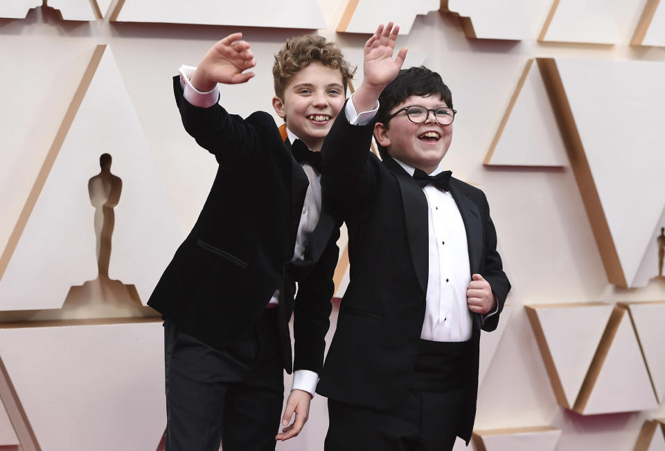 Roman Griffin Davis, left, and Archie Yates arrive at the Oscars on Sunday, Feb. 9, 2020, at the Dolby Theatre in Los Angeles. (Photo by Jordan Strauss/Invision/AP)